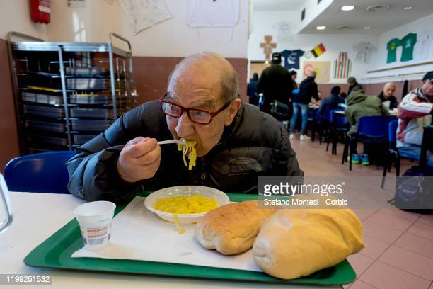 Man eats a free serving of Fettuccine Alfredo on National Fettuccine Alfredo Day on February 7, 2020 in Rome, Italy. For the 5th National Fettuccine...