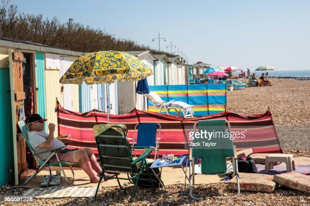 A man eats a plate of chips outside his beach hut during the warm weather on Bank Holiday Monday on May 7 2018 in Bognor Regis United Kingdom Britons...