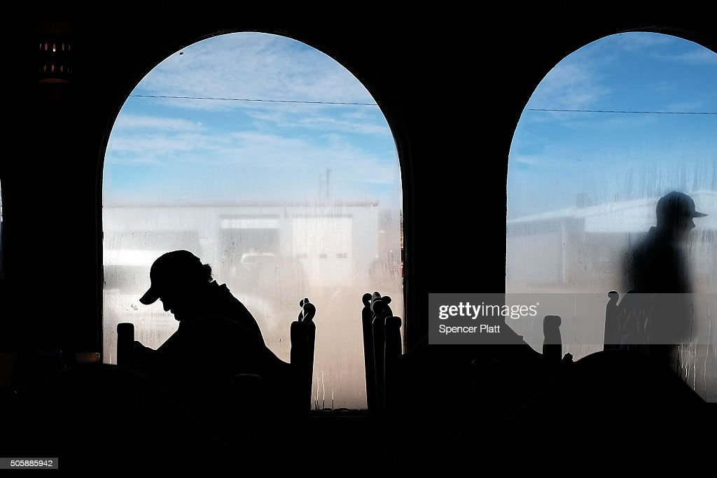 A man eats at a restaurant in the Permian Basin oil field on January 20, 2016 in the oil town of Andrews, Texas. Despite recent drops in the price of oil, many residents of Andrews, and similar towns across the Permian, are trying to take the long view and stay optimistic. The Dow Jones industrial average plunged 540 points on Wednesday after crude oil plummeted another 7% and crashed below $27 a barrel.