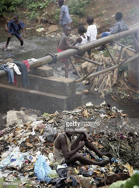 Man eats garbage from a pile November 26 2006 in Freetown Sierra Leone Sierra Leone was ravaged by a decade long civil war but peace was declared in...