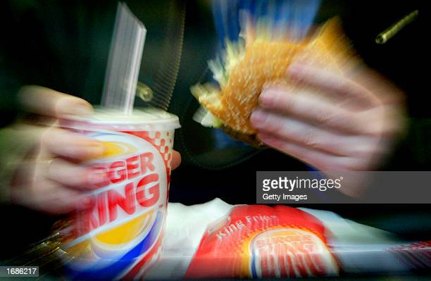 A man eats his lunch at a Burger King restaurant December 13 2002 in London Diageo PLC the world's largest liquor company has finalized the sale of...