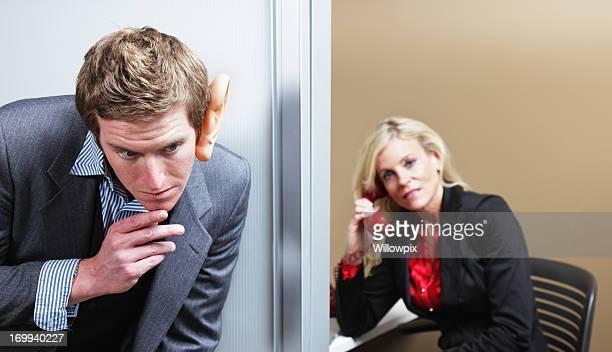 Man Eavesdropping On Woman