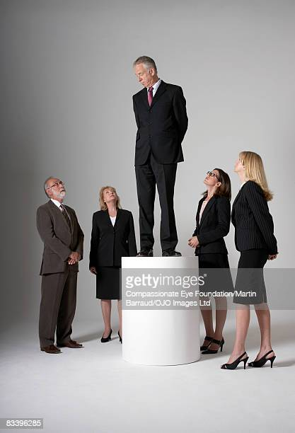 man elevated, looking down on a group of people - 後ろ手 ストックフォトと画像