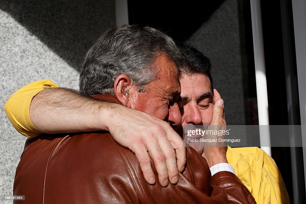 A man embraces Jose Manuel Gonzalez (R), brother of coal miner Orlando Gonzalez, who was killed by a gas leak in the Emilio del Valle well, part of the Santa Lucia coal mine, on the first of three days of mourning on October 29, 2013 outside the morgue in Pola de Gordon, in Leon, Spain. A methane gas leak killed six coal miners yesterday, while five others were injured at a depth of around seven hundreds meters.