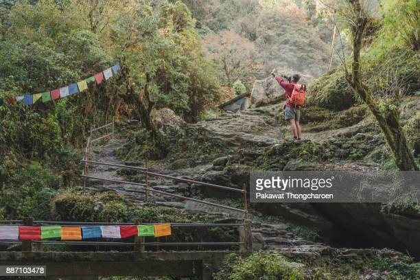 Annapurna, Nepal - November 20, 2017: Man Embracing in Nature