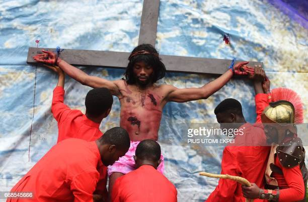 Man enacting Jesus Christ is attached to a cross during a procession organised by St Dominic Catholic Church to mark Good Friday in Lagos, on April...
