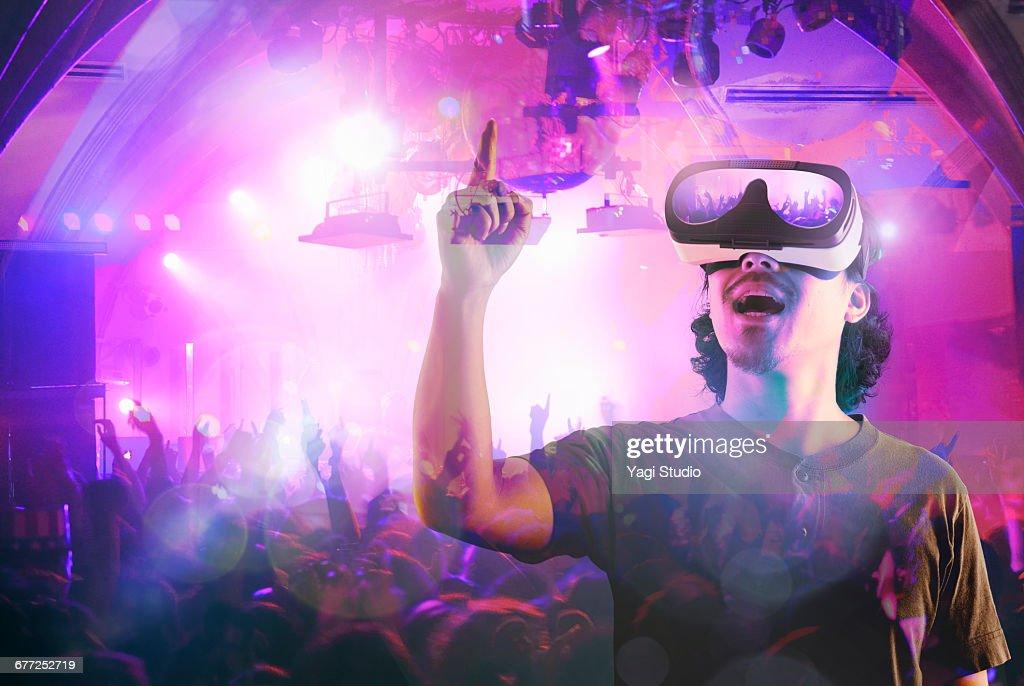 Man enjoying a club night in a virtual reality : Stock Photo