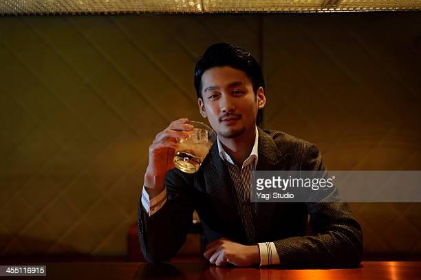 Man enjoying a drink at the bar