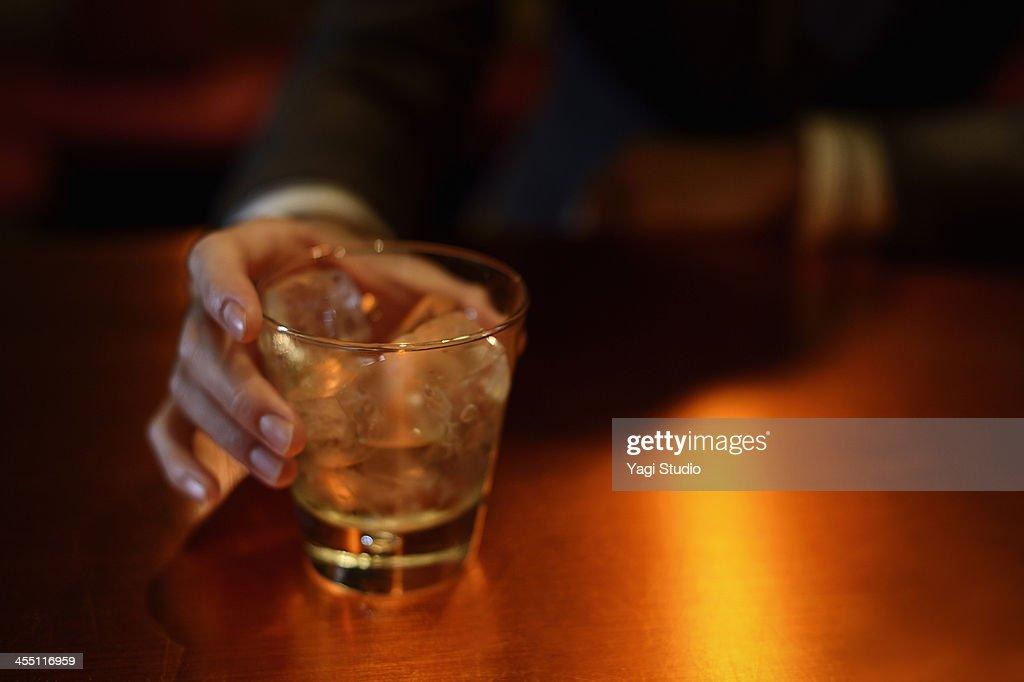 Man enjoying a drink at the bar : Stock Photo