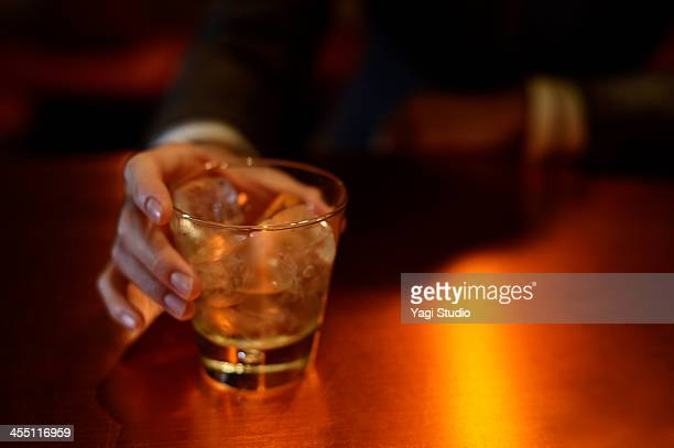 Man enjoying a drink at the bar
