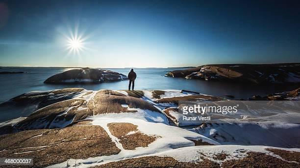 Man enjoying a sunny coastal landscape.