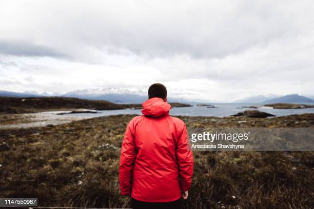 man enjoying a view of beautiful tierra del fuego landscape - patagonia stock pictures, royalty-free photos & images