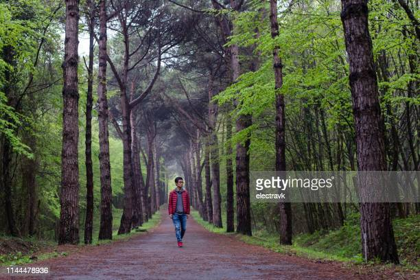 man enjoying a walk in nature - nature reserve stock pictures, royalty-free photos & images