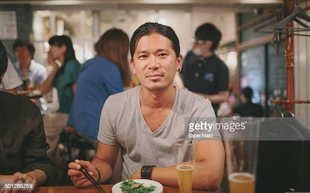 Man enjoying beer and food.