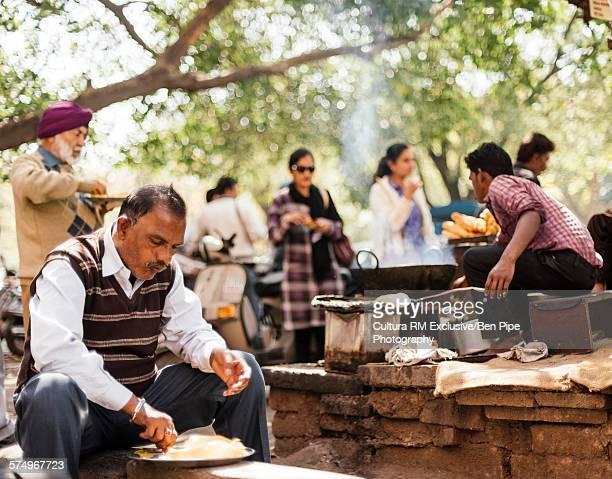 Man enjoying chole bhature, Chandigarh, Punjab Haryana