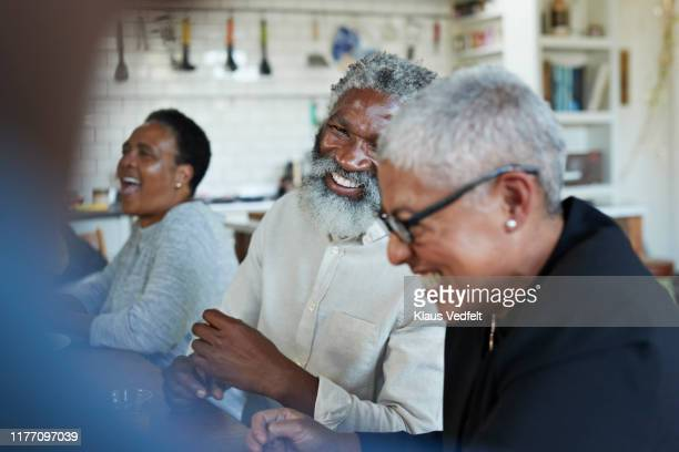 man enjoying christmas party with friends at home - party social event stock pictures, royalty-free photos & images
