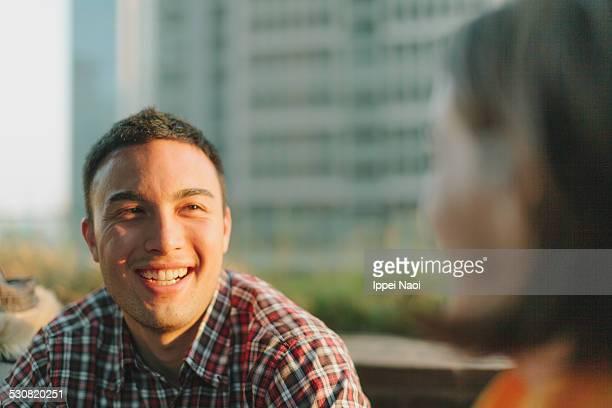 Man enjoying conversation at dusk
