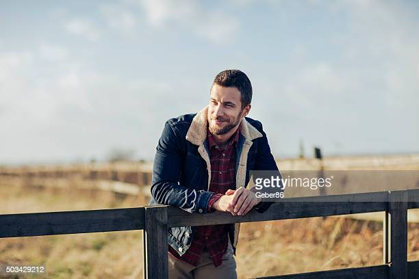 man enjoying country living - handsome muscle men stock pictures, royalty-free photos & images