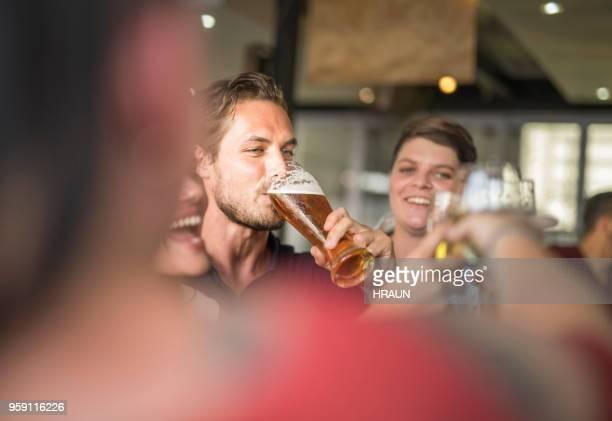 Man enjoying drinks with friends at bar