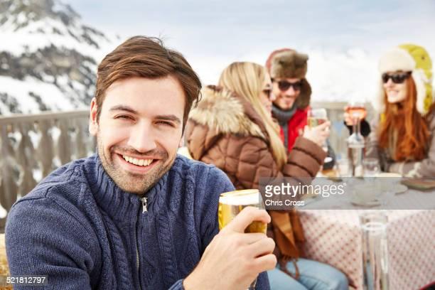 Man enjoying drinks with friends