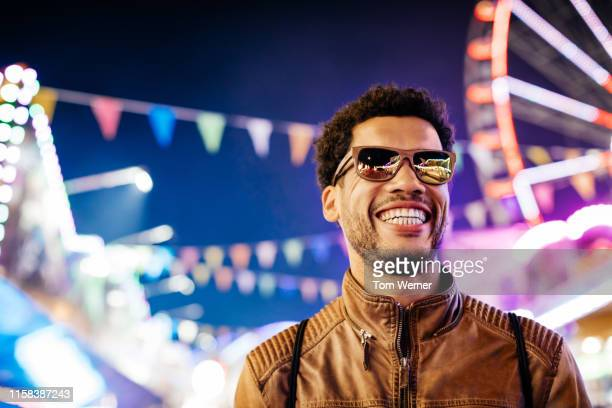 man enjoying evening at the fun fair - only mid adult men stock pictures, royalty-free photos & images