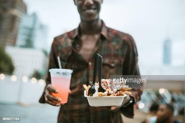 Man Enjoying Food Truck Life in New York