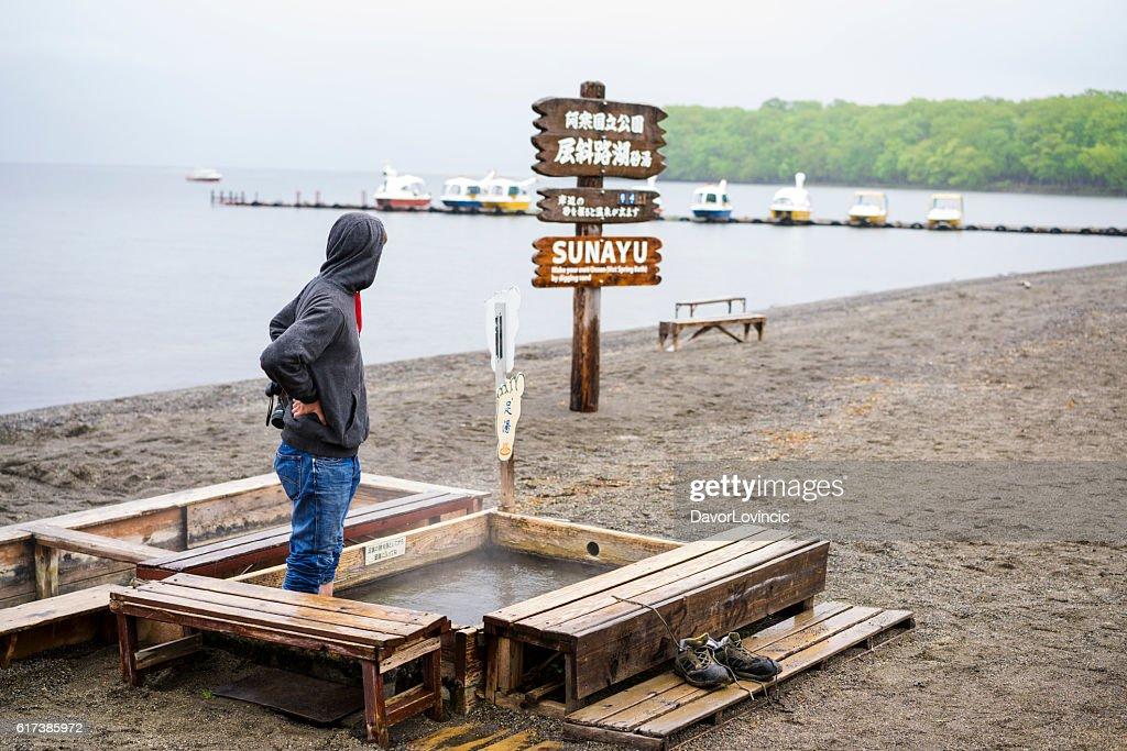 Man enjoying hot springs at Kushiro Lake, Hokkaido Japan : Stock Photo