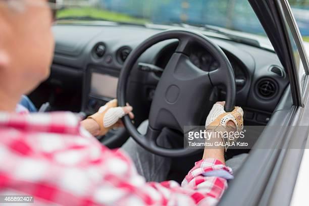 Man enjoying leisurely drive in sports car