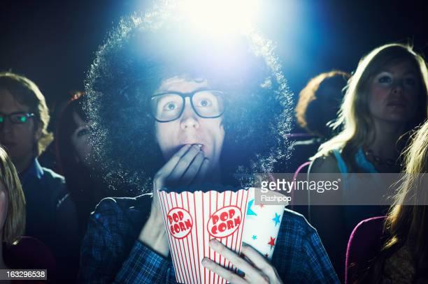 man enjoying movie at cinema - big hair stock photos and pictures