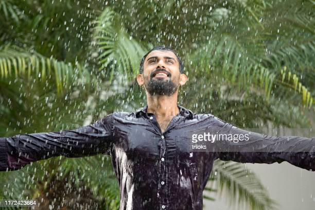 man enjoying rain - all shirts stock pictures, royalty-free photos & images