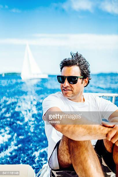 Man enjoying sailing with sailboat