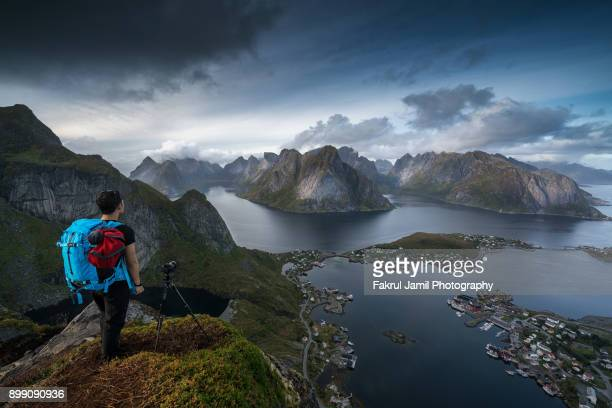 A man enjoying scenic view from atop Reinebringen mountain