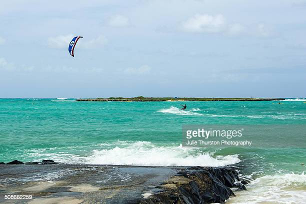 A Man Enjoying Some Recreation Kiteboarding in the Teal Pacific Ocean With Flat Island in the Distance at the Vacation Travel Destination of Kailua...