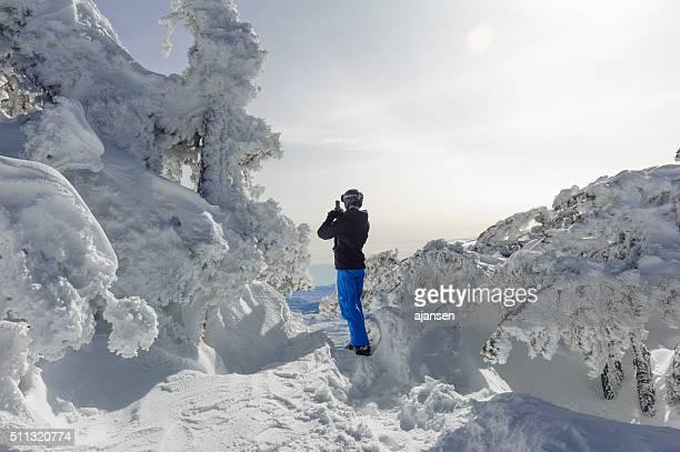 man enjoying the beautiful view on top of a mountain