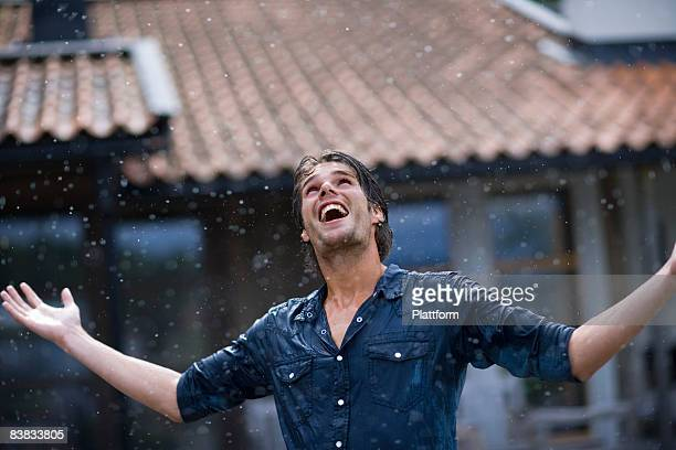 a man enjoying the rain sweden. - solo adulti foto e immagini stock