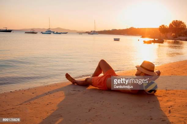man enjoying the sunset on the beach