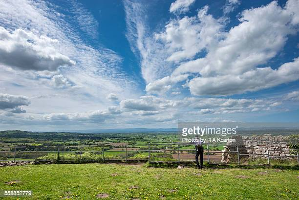 Man enjoying the view from Beeston castle, Cheshir