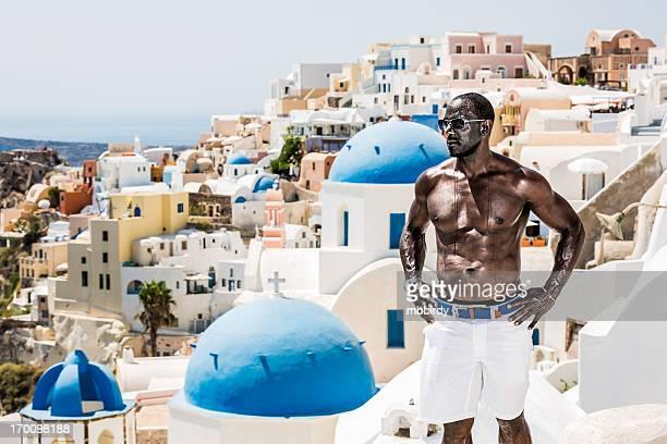 Man enjoying vacations in Oia village, Santorini island