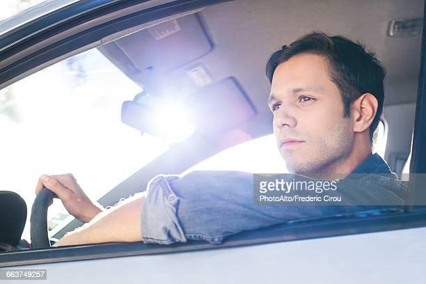 Man enjoying view as he drives car