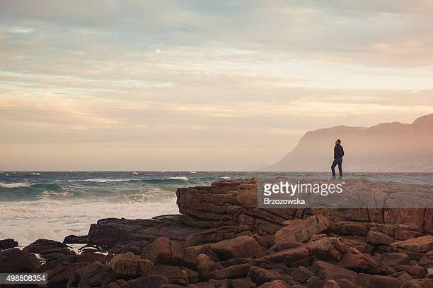 Man enjoying view of wavy ocean during sunset (South Africa)