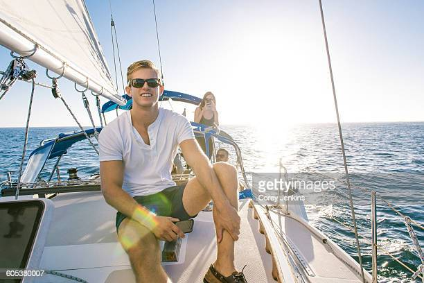 Man enjoying view on sailboat, San Diego Bay, California, USA