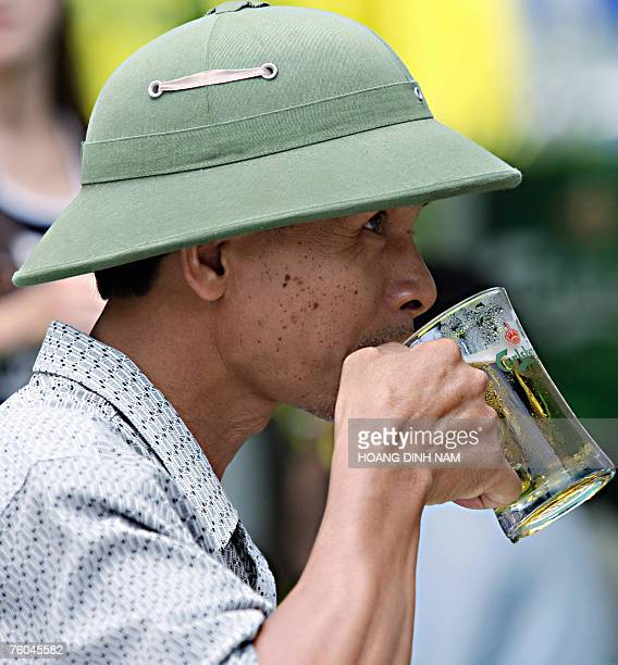 A man enjoys a beer during a local beer fair held for the first time in Hanoi 10 August 2007 Some 30 beer producers based in Vietnam are taking part...