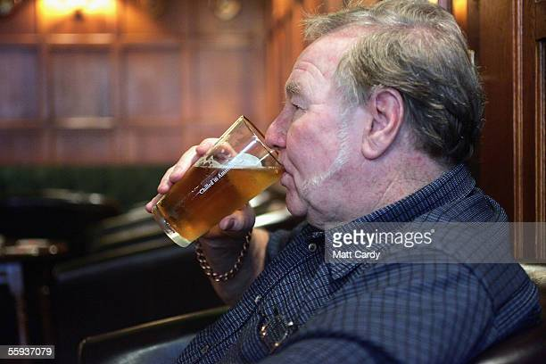 A man enjoys a drink in the Harrington Club a traditional gentlemans club in Bath on October 15 2005 in Bath England as pubs and clubs prepare for...