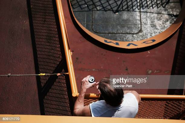 Man enjoys a drink on the Staten Island Ferry on August 3, 2017 in New York City. New York and much of the East Coast has been experiencing days of...