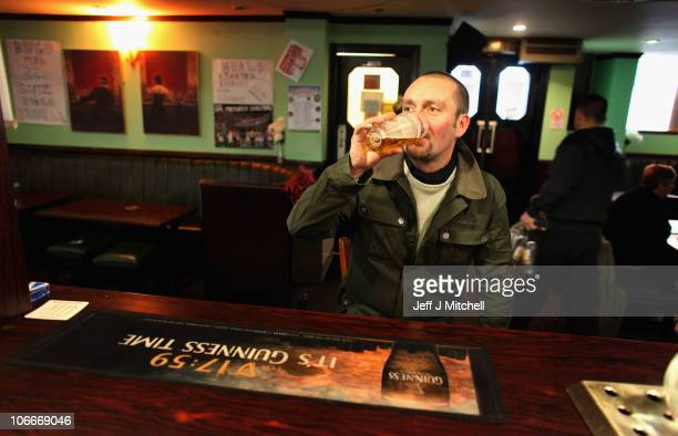 A man enjoys a pint of lager in a Govan pub on November 10 2010 in Govan Glasgow Scotland MSP's are set to vote on the SNP government's Alcohol Bill...
