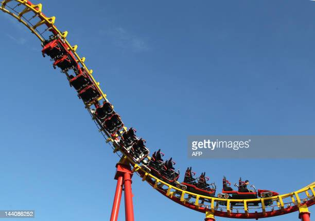 A man enjoys a ride on a roller coaster at Vienna Prater amusement park on May 9 2012 AFP PHOTO / ALEXANDER KLEIN