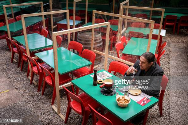 Man enjoys a Swiss cheese fondue as terraces reopened in Lausanne, on April 19 after Switzerland significantly eased its Covid-19 restrictions...