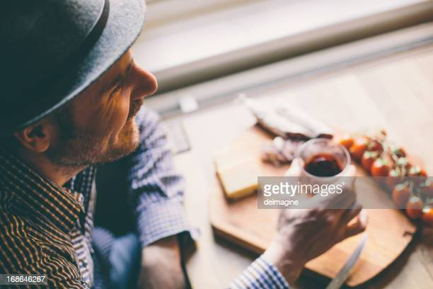 man enjoys his aperitif - tapas stock photos and pictures