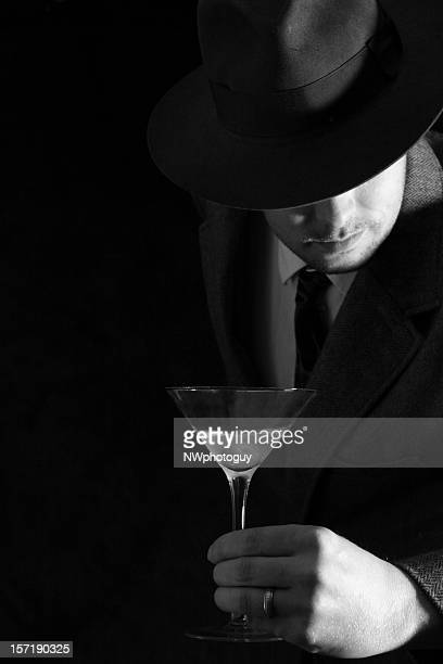 man enjoys martini - film noir style stock pictures, royalty-free photos & images