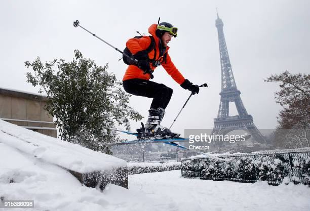 A man enjoys skiing at Trocadero square covered by snow in front of the Eiffel Tower on February 7 2018 in Paris France After exceptionally heavy...
